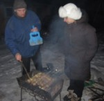 Vova and I freezing and drooling over the meat