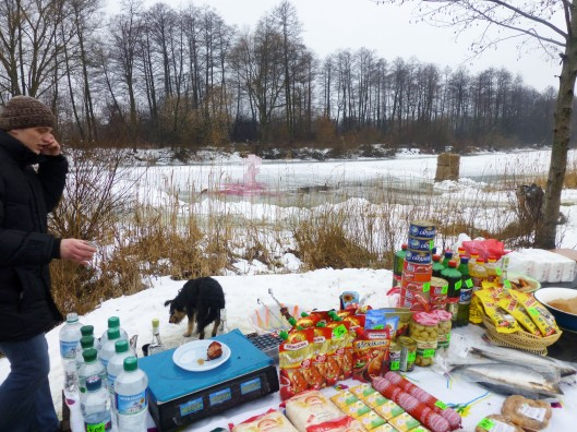 Ukrainian man, dog, food and river celebration...